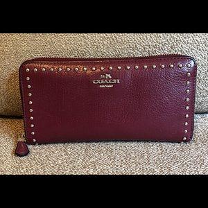 Burgundy accordion Coach wallet